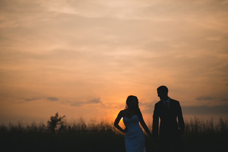 15-oklahoma-wedding-photographer-clauren-ridge-winery-vineyard-sara-memmott-tim-gilpin-couple-pose-sunset-silhouette