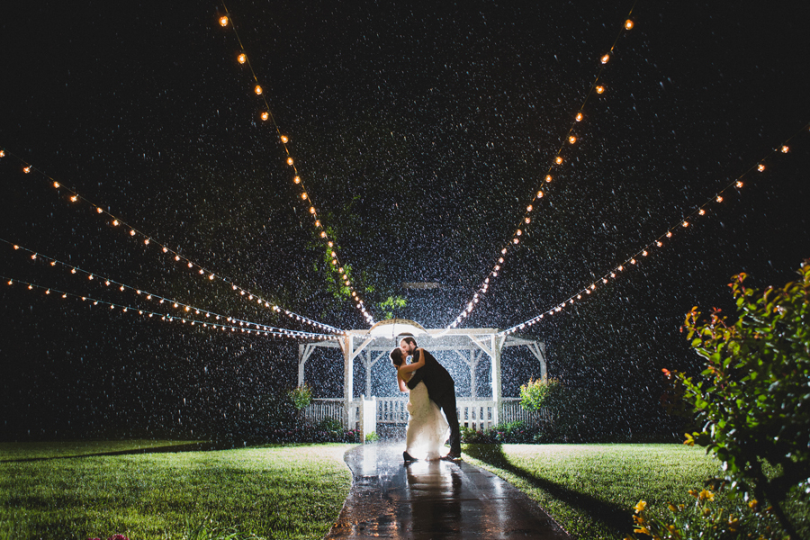 37-wings-edmond-rainy-wedding-magical-beautiful-backlight-flash-bride-groom-couple-portrait-outise-night-epic