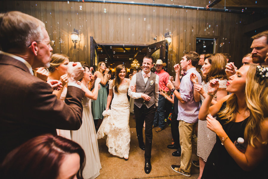 38-chisholm-springs-event-center-edmond-okc-wedding-photographer-exit-bubbles
