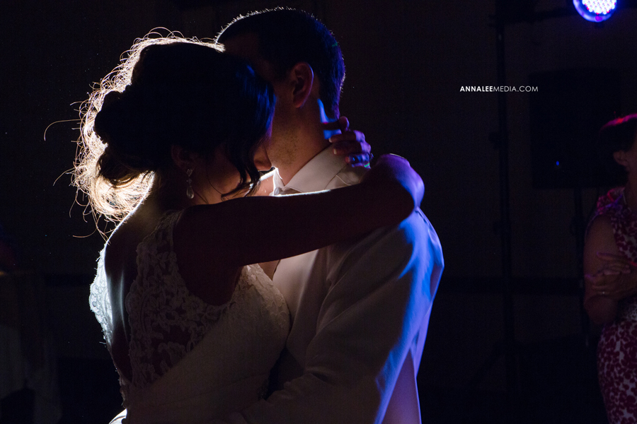 34-norman-oklahoma-wedding-photographer-lauren-buchanan-ryan-elassal-summer-2013-OU-University-of-Oklahoma-ballroom-reception-party-dance-backlight