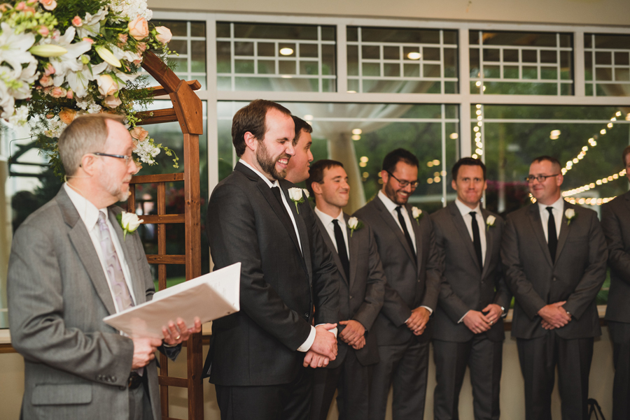 15-wings-edmond-wedding-rainy-indoor-ceremony-groom-first-look