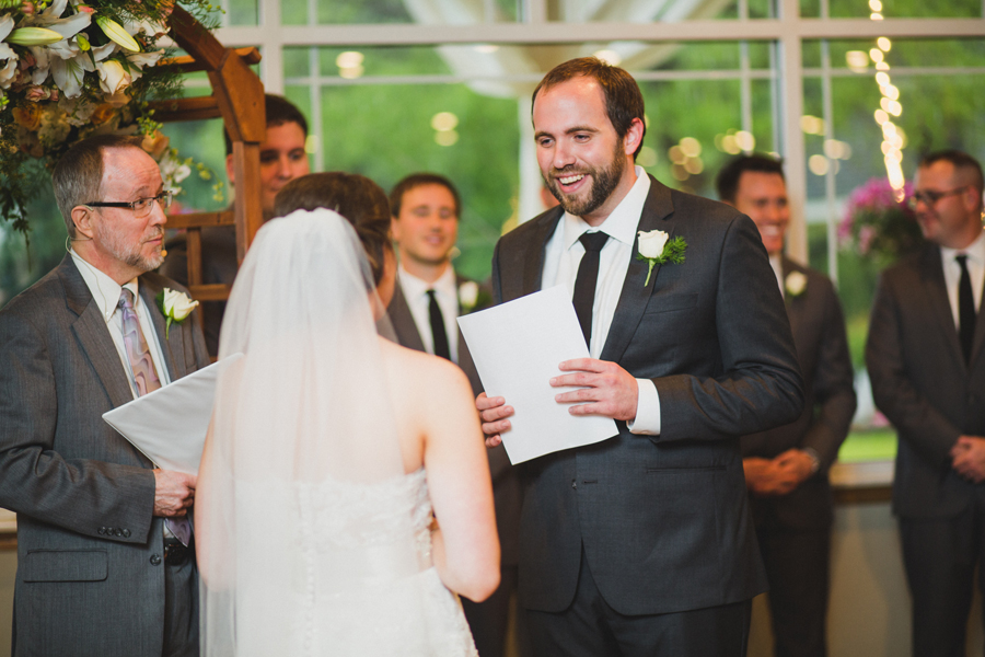 17-wings-edmond-wedding-rainy-indoor-ceremony-vows