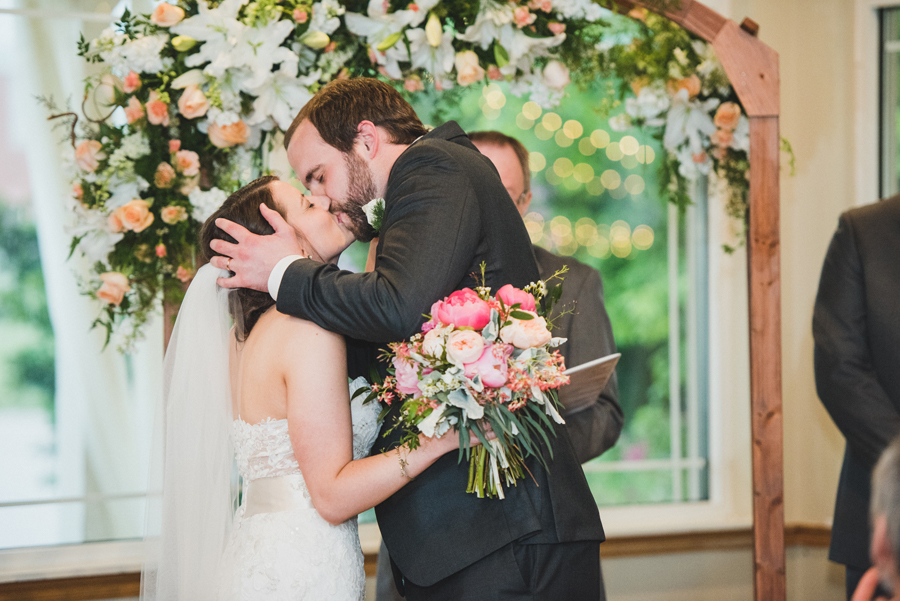 20-wings-edmond-wedding-rainy-indoor-ceremony-first-kiss