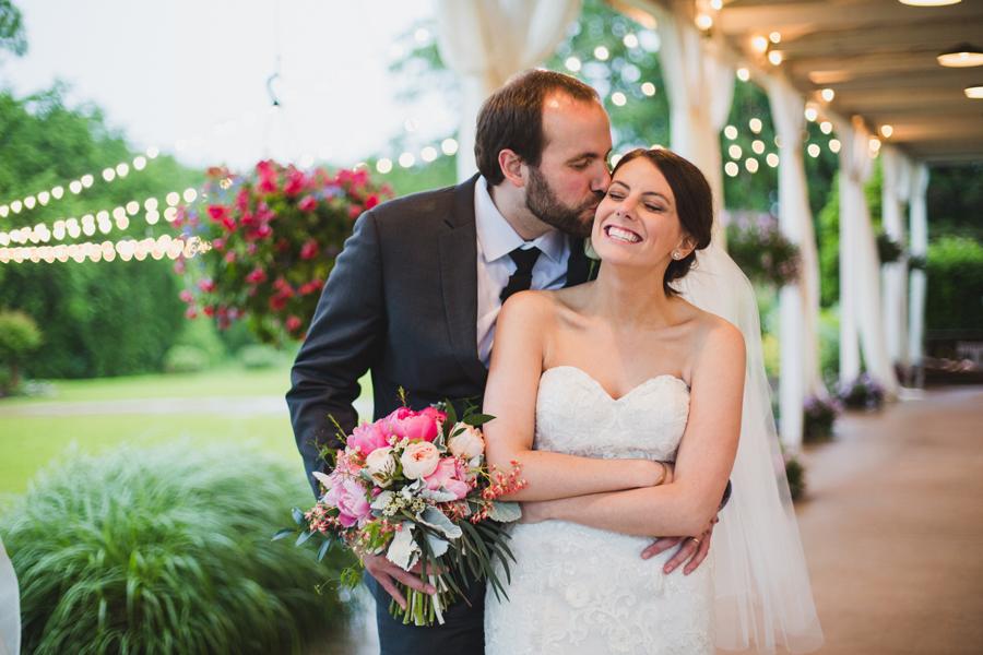 27-wings-edmond-wedding-rainy-bride-groom-couple-portraits