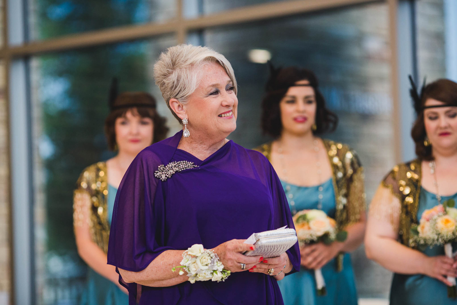 tulsa-oklahoma-wedding-photographer-gilcrease-museum-venue-steve-cluck-joy-jones-14-lobby-ceremony-rain-