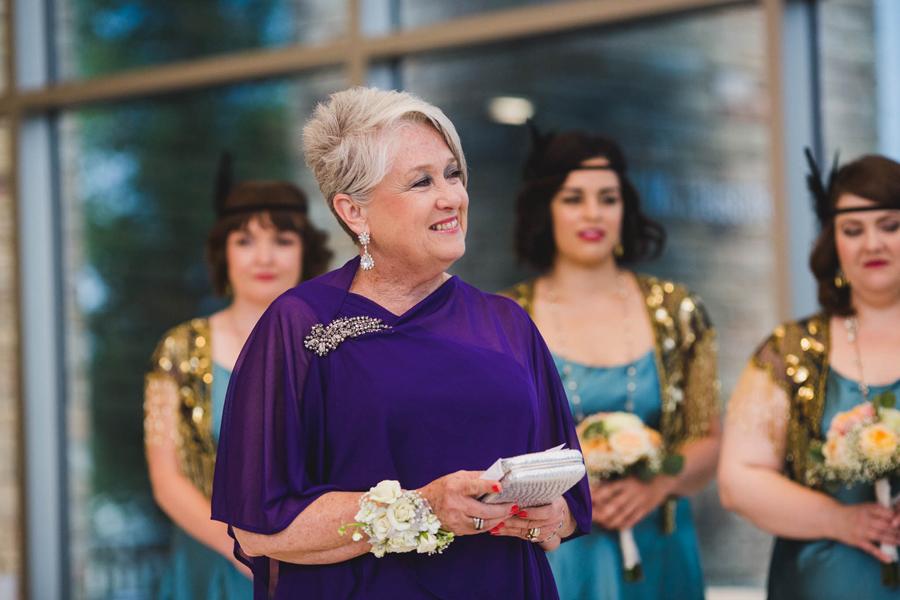 tulsa-oklahoma-wedding-photographer-gilcrease-museum-venue-steve-cluck-joy-jones-14-lobby-ceremony-rain-