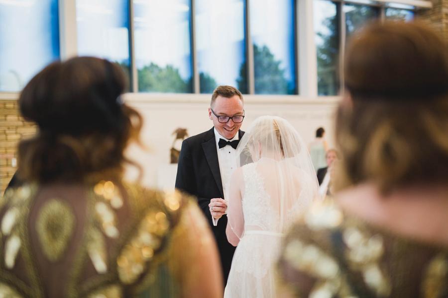 tulsa-oklahoma-wedding-photographer-gilcrease-museum-venue-steve-cluck-joy-jones-21-lobby-ceremony-rain-