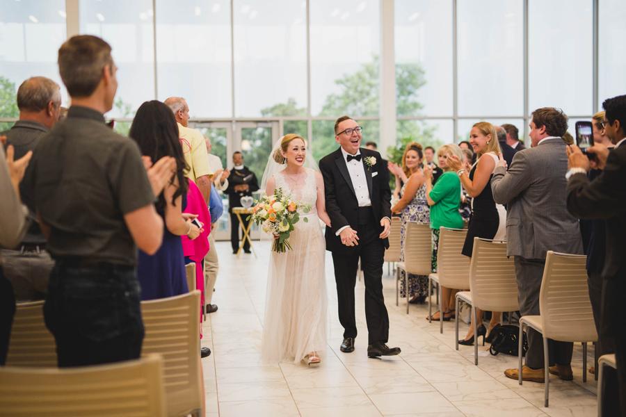 tulsa-oklahoma-wedding-photographer-gilcrease-museum-venue-steve-cluck-joy-jones-23-lobby-ceremony-rain-