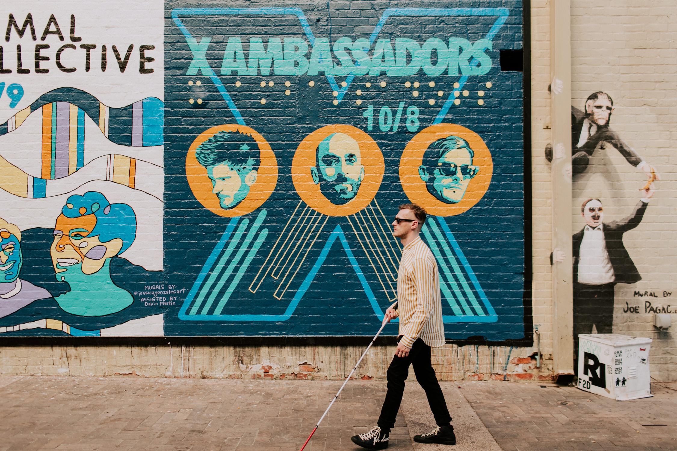 casey-harris-walking-by-mural-x-ambassadors-AnnaLeeMedia
