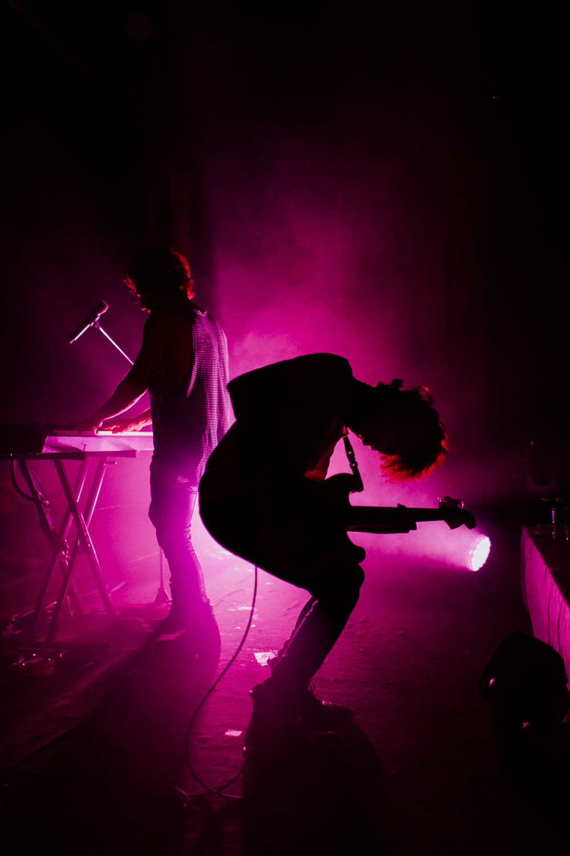 joe-intile-bass-pose-pink-silhouette-smallpools-AnnaLeeMedia
