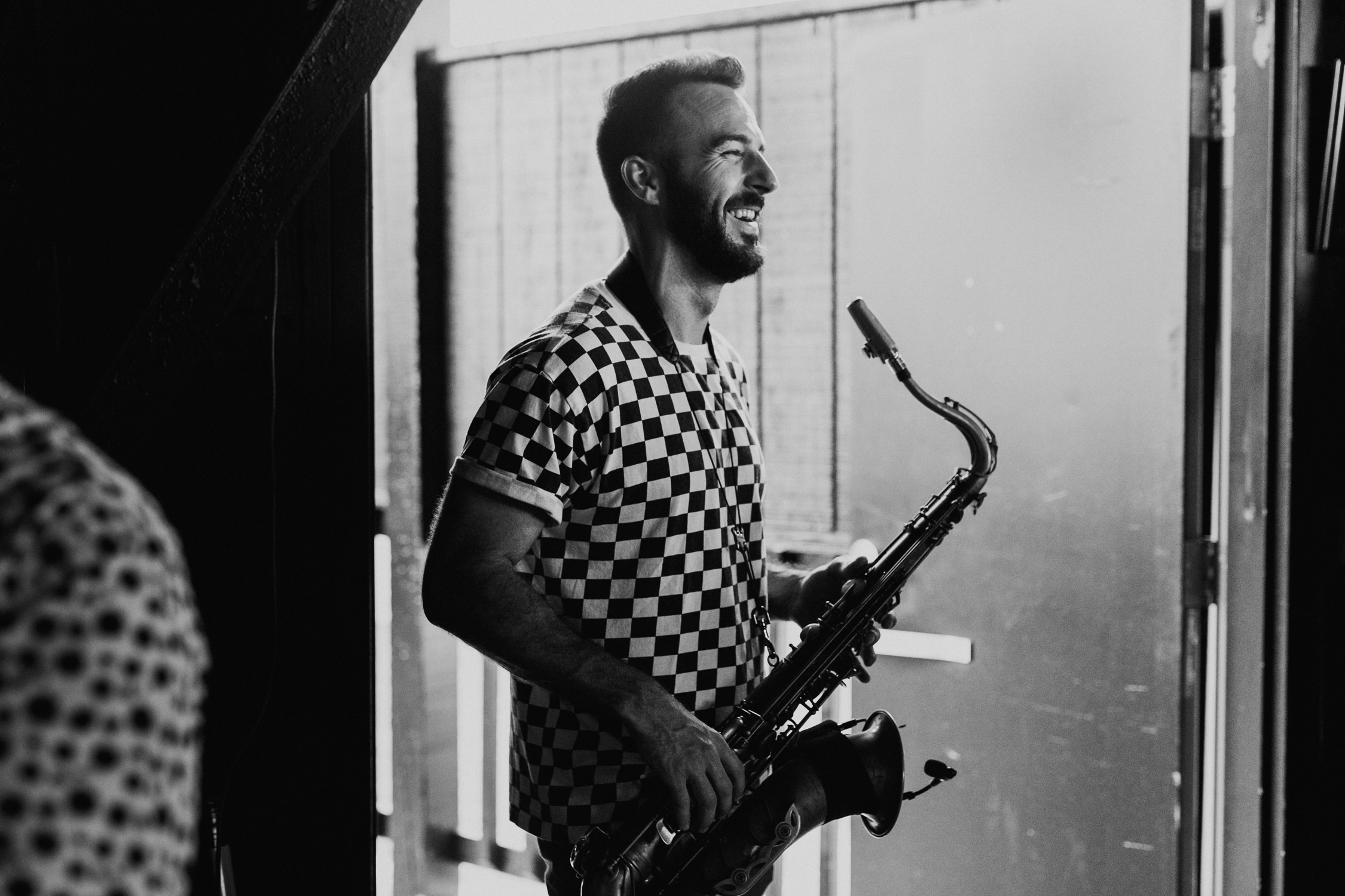 murph-sax-laughing-backstage-tour-AnnaLeeMedia