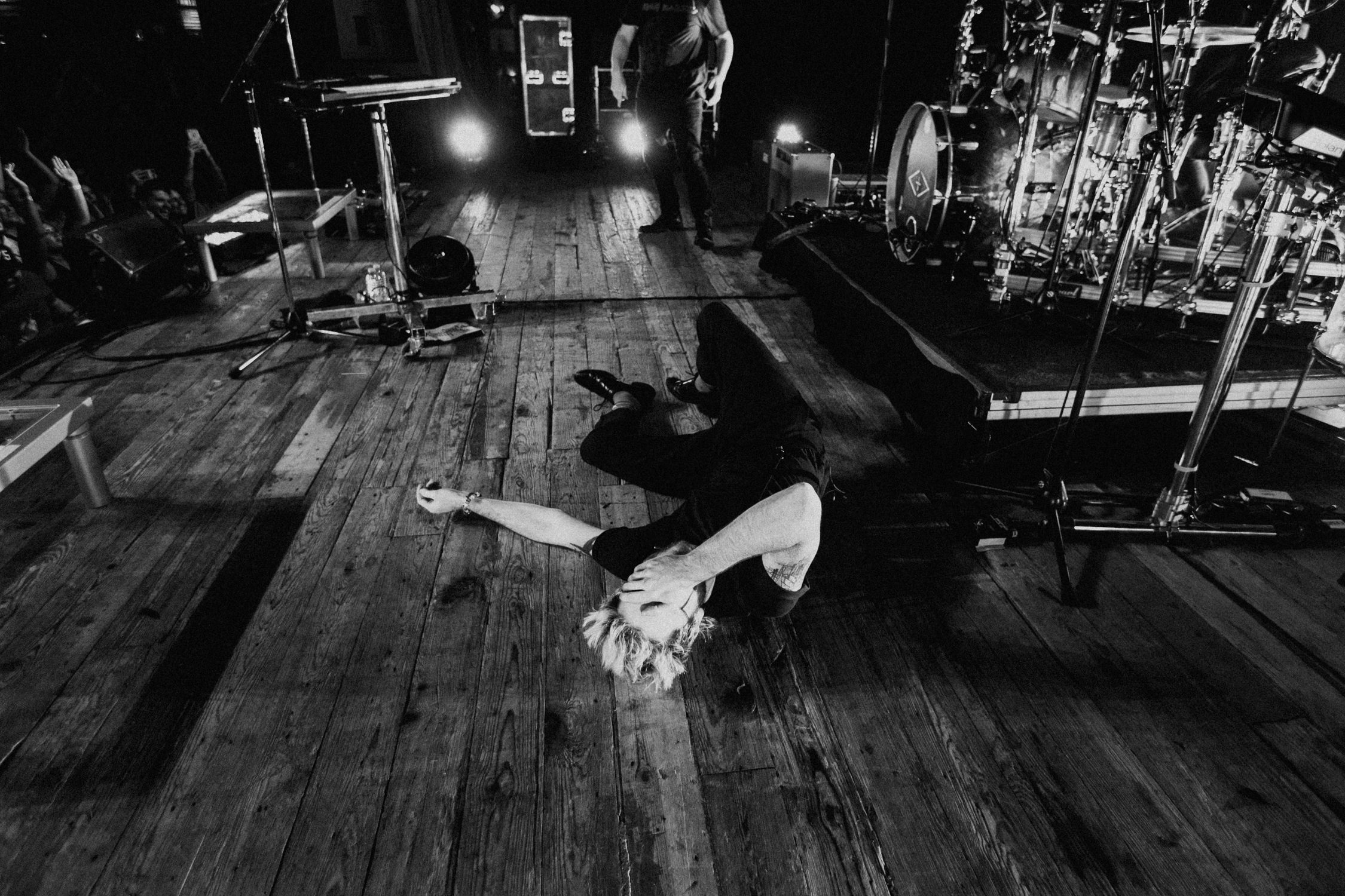 nick-laying-on-stage-encore-walk-the-moon-AnnaLeeMedia