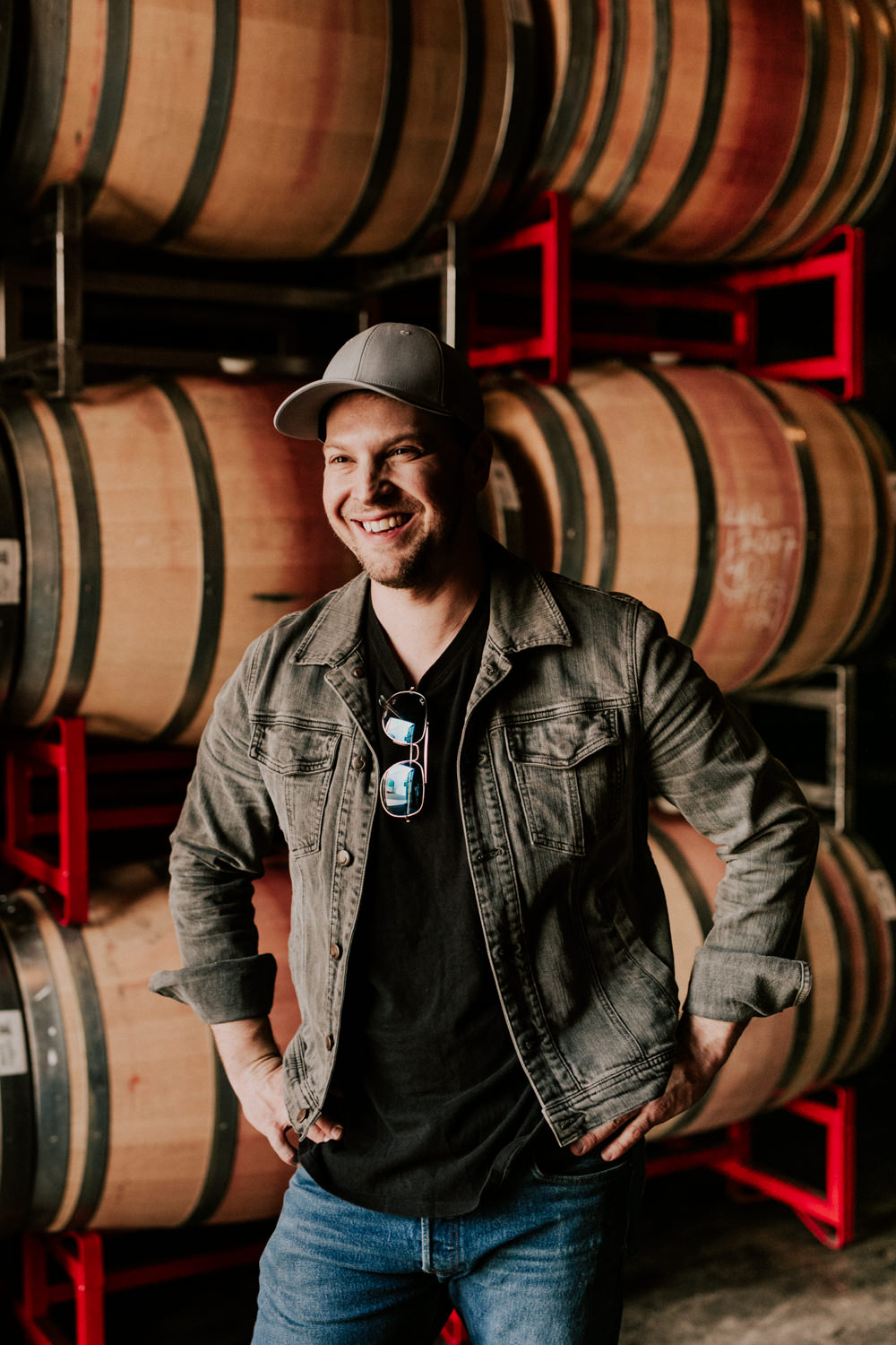 gavin-degraw-smiling-portrait-wine-barrels-vineyard-AnnaLeeMedia